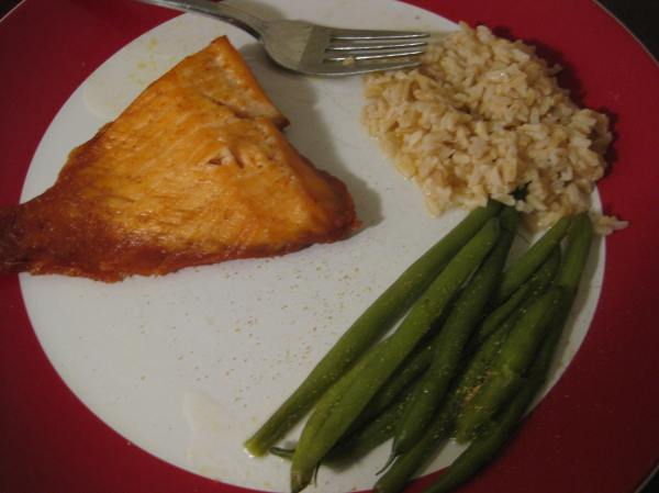 Baked salmon, brown rice, and steamed green beans with olive oil